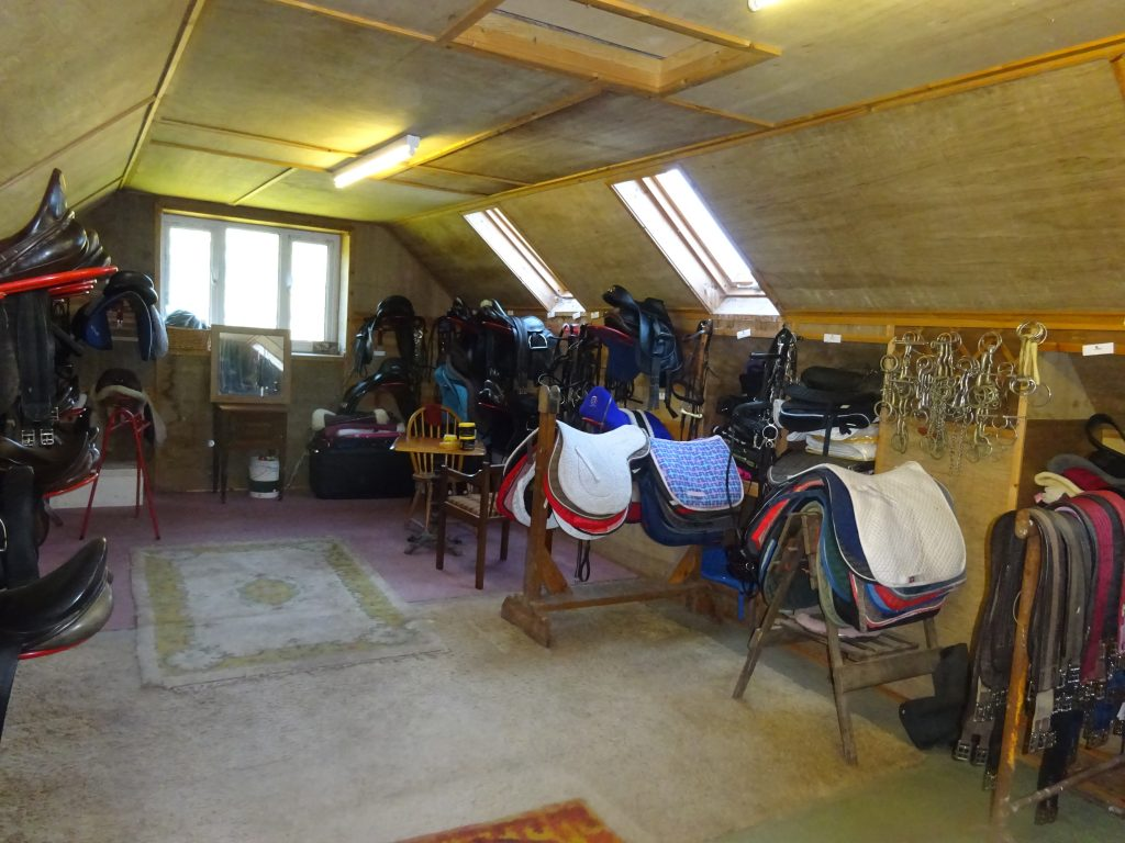 Livery room with horse tack
